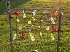 Colored bottles on an old metal garden gate at TreasureAgain