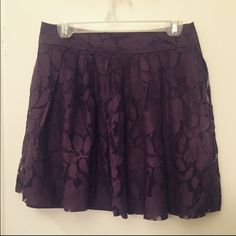 Loft Plum Lace A-Line Mini Skirt Super cute purple lace mini skirt from Ann Taylor Loft. If this skirt fit I would be keeping it! A-line style, zipper in the back. Beautiful plum color, perfect for fall and winter especially! Size 4P. I do not wear petite sizes, but I went down a size and worn this like a high waisted skirt so it is very versatile. Worn a few times, great condition, smoke free home. Make an offer! LOFT Skirts Mini