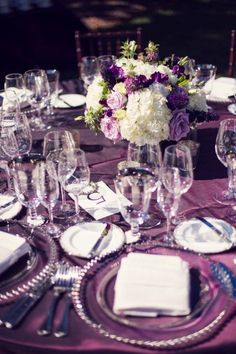 A purple linen is a bold way to show how elegant your wedding is in the California Wine Country. Glass chargers and white, blush, and purple flowers are a simple way to create a lovely table top design.
