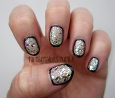 Nude glitter nails framed in black.