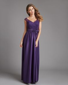 This classic bridesmaid dress features a draped A-line skirt, lace overlay and satin belt. The deep purple color will make your 'maids feel like royalty. @allurebridals