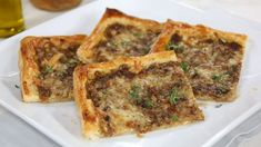 If you're a fan of French onion soup, you will absolutely love the tart version of it! A delicious appetizer that's made with Herbes de Provence, dijon mustard, Gruyere cheese and onions. Burger Cookies, Healthy Quiche, Brunch Appetizers, Onion Tart, Frozen Puff Pastry, Wordpress, Thing 1, Party Food And Drinks, Bon Appetit