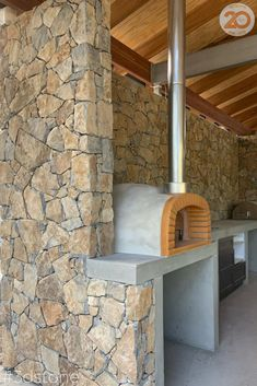 Gorgeous outdoor entertainment area to make a statement. Imagine a steaming pizza coming out of that oven as you watch the sunset! Those are the memories worth making Stone Facade, Stone Cladding, Wall Cladding, Modern Backyard Design, Stone Tiles, Outdoor Entertaining, Natural Stones, Entertainment Area, Outdoor Decor