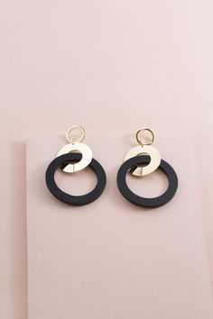 Color Pop Circle Earrings | Black $14 // Black and gold circle acrylic earrings with a 80's flare!