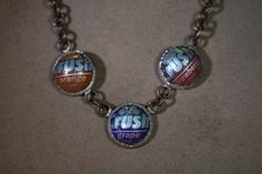 Show off your love for Crush soda with this bottle cap necklace. Old bottle caps made into fashionable jewelry.  These bottle caps are cut into small discs then domed then set in bezel set.