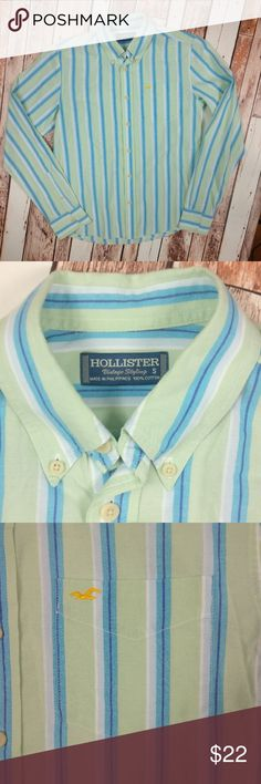 """Hollister """"Vintage Styling"""" Cotton Men's Button Up Hollister.  Vintage Styling (on the tag). 100% cotton men's button down shirt.  Light green with blues in the stripes.  Yellow, embroidered Hollister bird logo on chest pocket.  Gently used, good condition.  Approx. measurements laying flat & unstretched:  Chest across (armpit to armpit): 19.25"""" Length (top of shoulder to bottom): 24.5"""" (the back is a bit longer) Hollister Shirts Casual Button Down Shirts"""