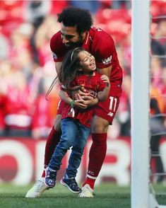 Mo Salah of Liverpool with his daughter after the Premier League match between Liverpool FC and Wolverhampton Wanderers at Anfield on May 2019 in Liverpool, United Kingdom. Get premium, high resolution news photos at Getty Images Liverpool Champions, Fc Liverpool, Liverpool Football Club, Champions League, Major League Soccer, Football Players, Who Is His Wife, Mohamed Salah Liverpool, Arab Celebrities