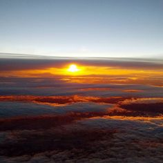 The sun is setting and turning everything a shade of orange. It is so pretty up here.  #upintheair #upinthesky #sunset #32000feet #igtravel #travelpic #wanderlust #travel #traveling #instatravel #travelphoto #instapassport #tripgram