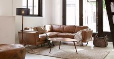 "The Timpani charme tan ottoman says ""hey girl, put your feet up."" The tufted leather ottoman has a solid brass base that makes it a nice footrest… and a great coffee table. Furniture Direct, High Quality Furniture, Furniture Ideas, Mid Century Modern Design, Mid Century Modern Furniture, L Shaped Coffee Table, Coffee Table Pictures, Wooden Trim, Living Room Sectional"