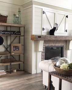Loving this fireplace and the shelving next to it!