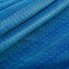 Didymos is a major player in the babywearing world. With beautiful, playful and elegant designs, there's a Didymos woven wrap or ring sling baby carrier for all! Modern Cloth Nappies, Cloth Diapers, Jacquard Fabric, Jacquard Weave, Maya Wrap, Baby Wearing Wrap, Under The Nile, Baby Wrap Carrier, Ring Sling