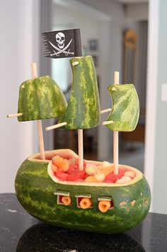 Watermelon pirate ship! Would be cute at a pirate birthday party!