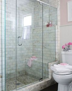 river-rock-tiled floor that are easily seen through a frameless glass shower enclosure. The glass enclosure stair-steps up a marble frame, highlighting the shower bench and a toiletry shelf Shower Remodel, Shower Enclosure, Shower Bench, Bathroom Makeover, Small Bathroom With Shower, Bathroom Design, Bathroom Decor, Bathroom Renovation, Bathroom Redo