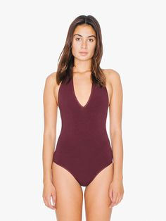 Halter bodysuit featuring a low cut V-neck and open back.