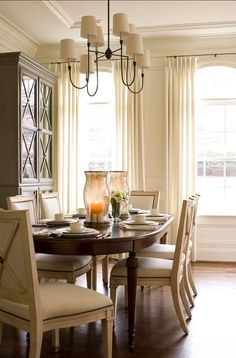 """Dining Room Chandelier. Light fixture is""""Thomas O'Brien's Vendome Large Chandelier""""."""