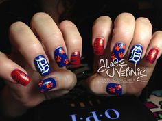 lotsafingerpaints:  Detroit Tigers!  Oh you KNOW I have to reblog this killer set of nails repping my hometown team!