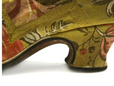 Russian Shoe Museum - Yellow and green in colour, with a woven design of foliage and fruit, designed for buckle fastening. Great Britain. c. 1740