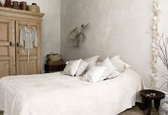 modern rustic - White bedding and a huge armoire