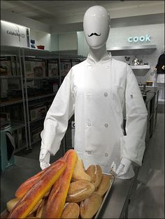 Mustached Mannequin with Food Props in Retail Fashion Themes, Food Displays, Visual Display, Visual Merchandising, Chef Jackets, Retail, Theme Ideas, Baked Goods, Cosplay