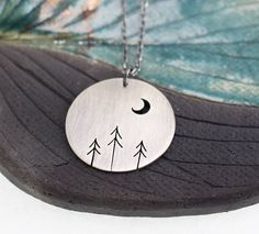 Jewelry Making Table Forest of Three Pines and Crescent Moon Tree Art sterling silver statement round pendant. Jewelry Making Table Forest of Three Pines and Crescent Moon Tree Art sterling silver statement round pendant Jewelry Art, Jewelry Gifts, Jewelery, Cement Jewelry, Silver Jewellery, Pendant Jewelry, Hand Piercing, Graduation Jewelry, Earring Tree