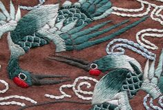 ~ Small detail of chinese embroidery depicting cranes worked in blue satin stitch on brown fabric. From the handling collection at Bankfield Museum #TraditionalCulture