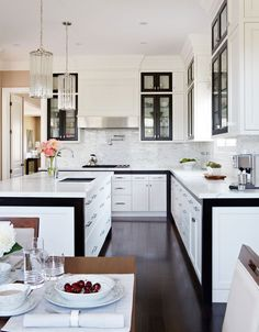 Stunning white kitchen with walnut accents. Love the lighting as well. Knight Moves: White + Walnut Kitchen by Gluckstein Home Home Kitchens, Kitchen Remodel, Kitchen Design, White Modern Kitchen, Kitchen Inspirations, Kitchen Decor, Kitchen Interior, Home Decor, Kitchen Style