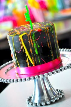 Glow in the dark splatter-paint cake.