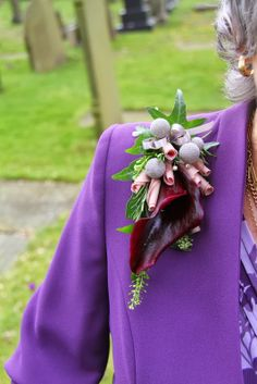 One of our lovely Epaulette Corsages with a deep aubergine Calla Lily with rolled Memory Lane Rose Petals, Thalaspi, Rosemary and Albiflora Berries