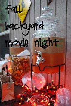 fall backyard movie night- holiday lights around the treats