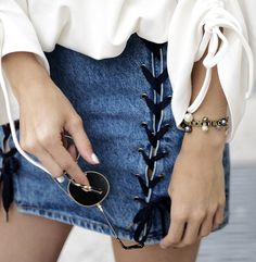 lace up denim skirt paired with a flowy blouse and dainty accessories