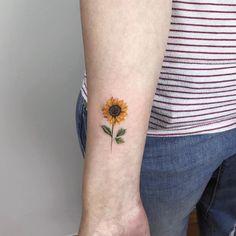 Tattoo red poppy tattoo on shoulder tiny flower tattoos on arm sun Sunflower Tattoo On Wrist, Sunflower Tattoos, Sunflower Tattoo Design, Watercolor Sunflower Tattoo, Wildflowers Tattoo, Poppies Tattoo, Tattoo Flowers, Tattoo Ideas Flower, Wrist Flowers