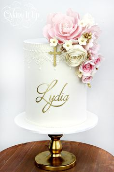 1 tier christening cake featuring cascading sugar flowers, edible lace and handpainted name. www.facebook.com/cakingitup