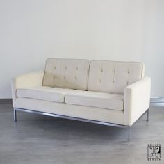 Sofa designed by Florence Knoll. One of these in black leather for me please!