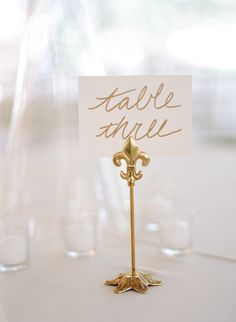 WE ♥ THIS!  ----------------------------- Original Pin Caption: chic wedding reception table number holder; photo: Ashley Upchurch