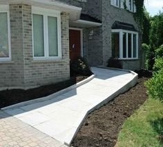 "Here's an accessible home done right! Hit ""like"" if you approve of this understated wheelchair ramp!"