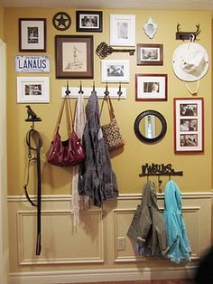 Entryway gallery wall with hooks...  I love the mix here.