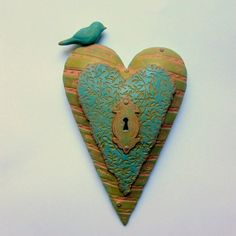 These hearts are like little pillows for the wall. Completely sculpted by hand. They are hollow, lightweight and adorable!    No two are alike and