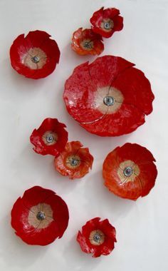 Nine Poppies by Amy Meya. These hand-carved porcelain pieces are a burst of color for the wall. This set of nine takes a 60