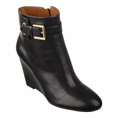 """Almond toe bootie with buckle detail.  Single sole 3 1/4"""" wedge bootie.  Full zipper closure.  Leather upper.139zapper"""