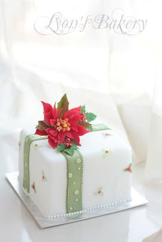 christmas cake poinsettia Christmas gift by Lyons Bakery - beautiful Christmas Cake Designs, Christmas Cake Decorations, Christmas Sweets, Holiday Cakes, Noel Christmas, Christmas Baking, Xmas Cakes, Christmas Gift Cake, Elegant Christmas