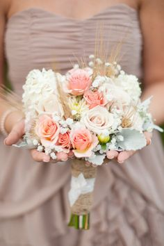 Love the pops of peach against the blush in this bouquet.