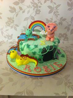 Girly dinosaur cake. Rainbow, stream. Fondant cake/figures