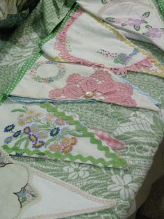 vintage linen bunting, I will now look for old embroidered table cloths to make myself one if these beauties!