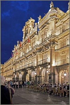 The Plaza Mayor in Madrid is an amazing sight to see at night! madridfoodtour.com