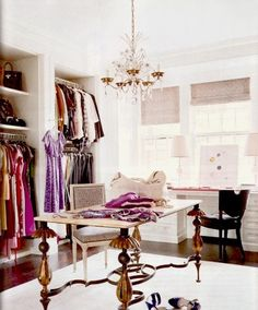 a room turn into a closet with windows...very nice. love the flamboyant but very open table base, example of great use of space. the black chair is simple but with the chandelier helps to anchor and at the same time give visual flow to the room