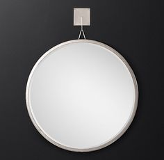RH Modern's Pendant Round Mirror:Inspired by a distinctive mid-century design, our mirror pairs a slender metal frame with a single beveled plate of glass, all gracefully suspended from a stylized pendant.