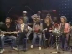 "Carl Perkins & Friends (George Harrison, EricClapton, Ringo, Roseanne Cash, Dave Edmunds, more)  - 1985 Rockabilly Session - ""That's All Right, Mama"", ""Blue Moon of Kentucky"", ""Night Train to Memphis"", ""Amen""."