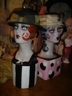 This is a 19 styrofoam mannequin head that I have painted in a vintage style smoking flapper boudoir doll with attached pedestal for added weight,