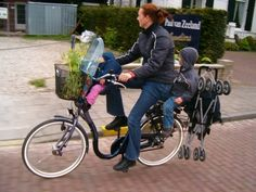 This is how we roll in Holland: mom with 2 kids, groceries, and a stroller on a bicycle :))