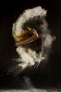 Awesome idea for photos of an athlete or dancer..... This is a flour shot, dark studio with black background. get the lighting right & it's just down to timing.....